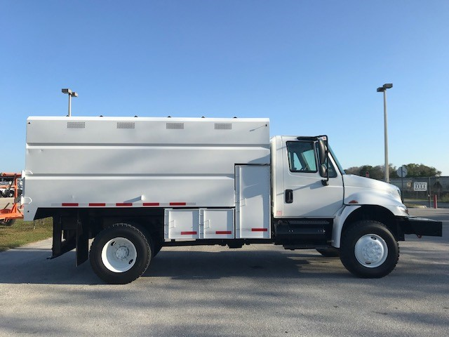 STOCK # 64798  2012 INTERNATIONAL 4300 4X4 CHIPPER DUMP TRUCK